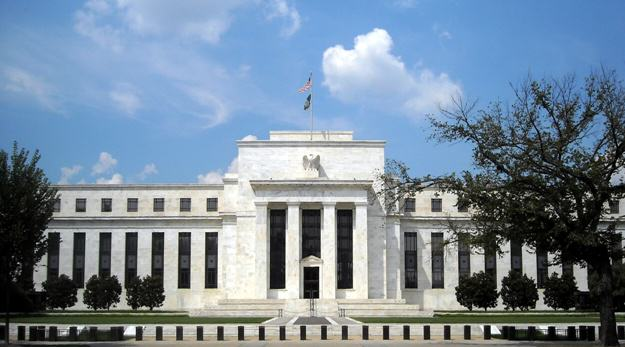 Fed Minutes Give Boost to Stock and Bonds